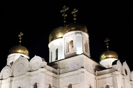 Bell tower and golden domes with crosses. The Cathedral of Christ the Savior (Savior Cathedral) at night. Pyatigorsk, Russia