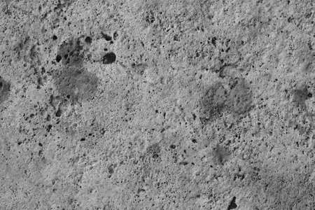 Natural rough stone surface. Black and white image. Background Stock Photo