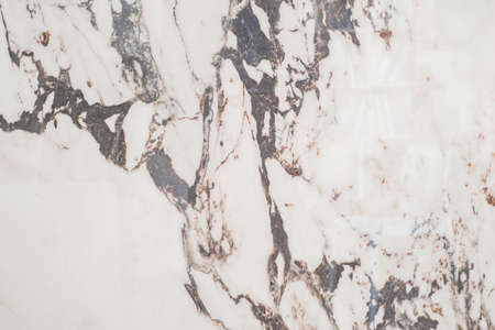 white marble stone. The texture of the stone slab, in a calm tone. Closeup marble texture
