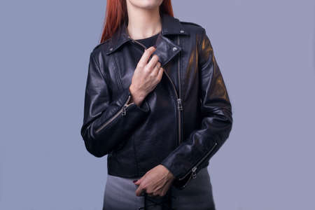 portrait of a girl in a high-quality leather jacket. Rock and roll style in women. Promotional photo of a leather jacket. Sale of leather goods, including jackets