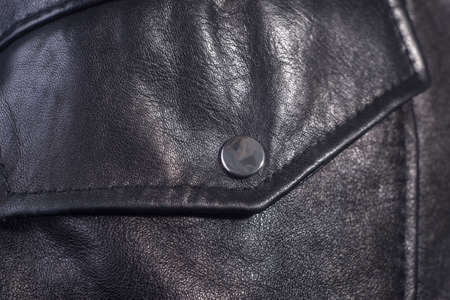 close-up of black leather jacket details Close-up jacket made of high quality leather, pocket with button.