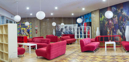 Zaporozhye. Ukraine. March 2020 Panormanny photo of the waiting room in the cinema, on the background of a poster with recognizable films. Editorial