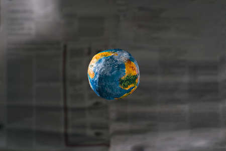 The concept of the world press. focus is the layout of the planet Earth on the background of a defocused blurred newspaper. The world of the press. World global press. Media media concepts illustrating world news, planet earth press Stock Photo