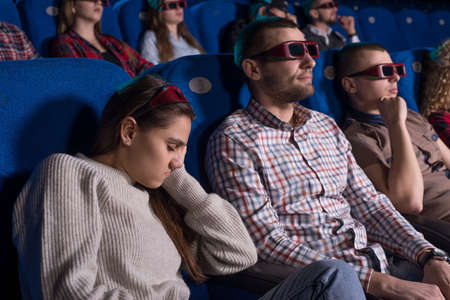 The general plan of young people of different sexes from nineteen to thirty years. People sleep while watching a boring movie. Stockfoto