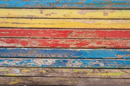 old wood texture with cracked LGBT rainbow paint vintage colorful wood background