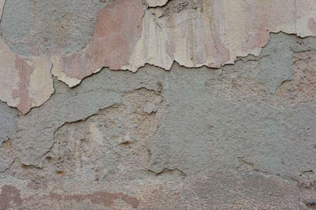 warm shades vintage texture of plaster outdoors at home Old peeling plaster of grunge wall texture