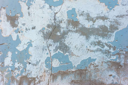 blue with dark blue old plaster texture on the street wall of the house old blue paint weathered no frame wood board texture background
