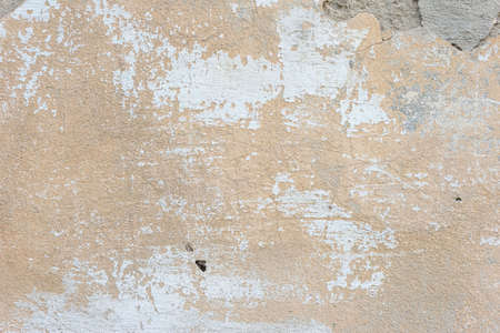 texture of brown old plaster on the street wall of the house. Warm shades Old Wall Texture