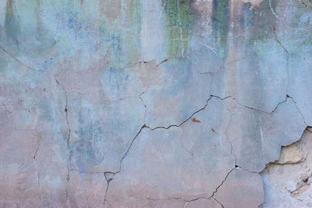 pink texture of old plaster on the street of the house cracked concrete vintage wall background, old wall Foto de archivo