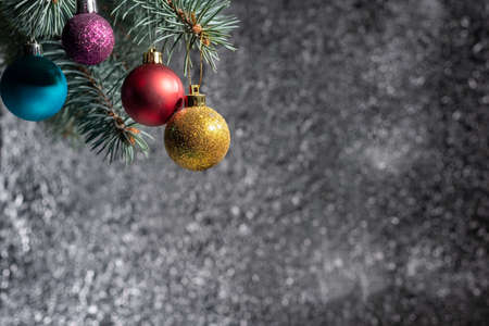 multicolored christmas toys on a silver abstract bokeh background Christmas balls on abstract background