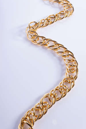 thick gold chain on a white background, top viewthick gold bracelet isolated on white