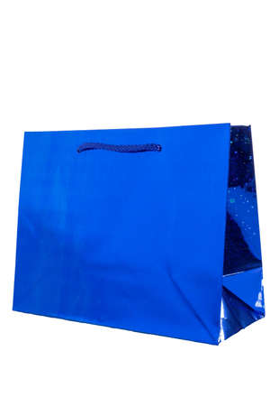 blue shiny gift bag. isolate on white background shopping bag made from recycling blue paper Foto de archivo
