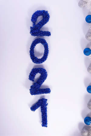 new year decorative numbers laid out 2021, christmas on white background. Foto de archivo