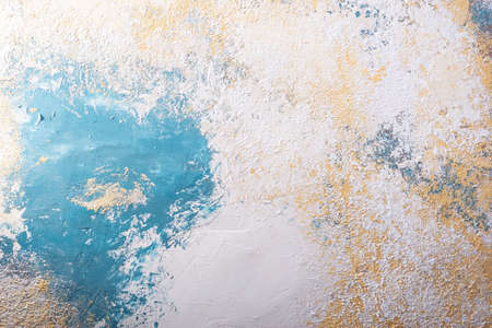 texture of decorative white-blue plaster with elements of a warm beige shade.