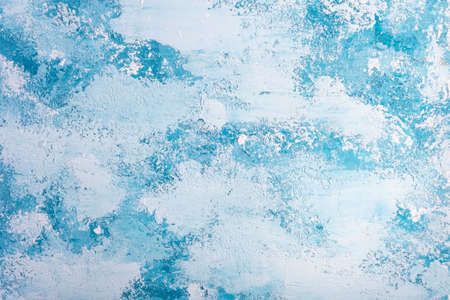 blue-white texture of decorative plaster. Christmas background, top view It is white - a dark blue background in grunge style.