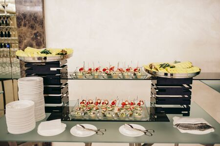 buffet with snacks on the event Standard-Bild - 140554448