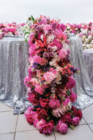 Pink peonies and other flowers decoration on a festive table