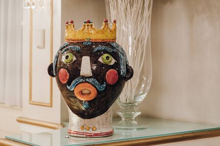 Traditional sicialian vase in form of the head of the prince in crown