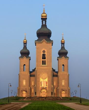 encroaching: Roman Catholic church Markham Canada on sunrise