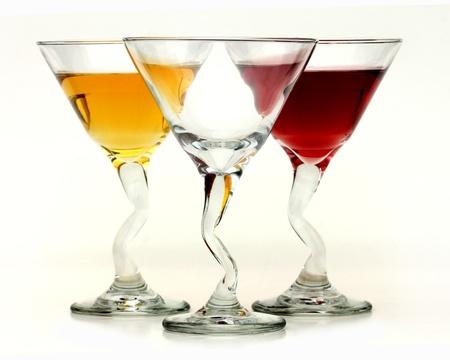 Three elegant crystal cocktail glasses isolated on white background  Stock Photo