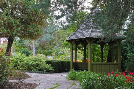 Wooden gazebo surrounded by colorful fall foliage in Toronto park Ontario Canada