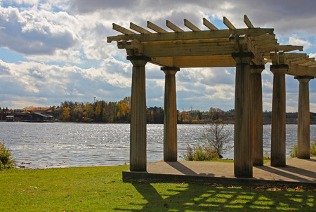 Scenic view of old shaded arbor over Seneca lake.