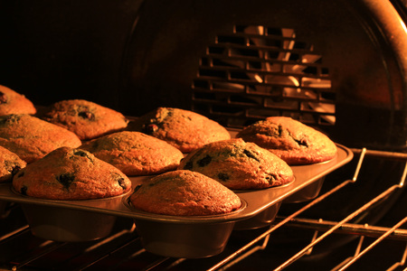 tin: freshly baked muffins in stove