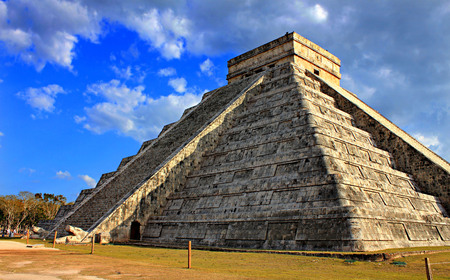 Mayan pyramid over blue sky at equinox day Chichen Itza Mexico