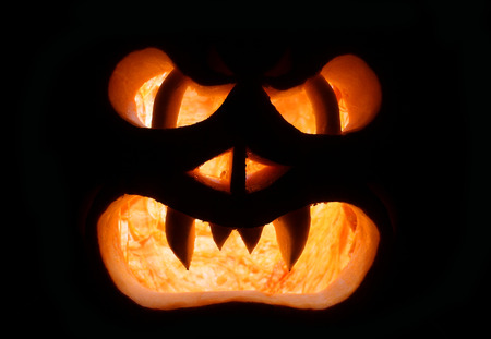 A Grinning Jack O Lantern Against a Dark Background Stock Photo