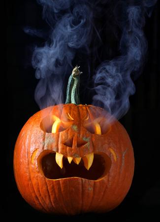 Smoking Halloween pumpkin head with copy space Stock Photo