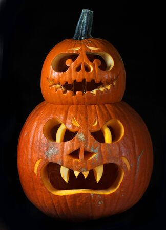 Scary Halloween pumpkins Jack O Lanterns isolated on black background