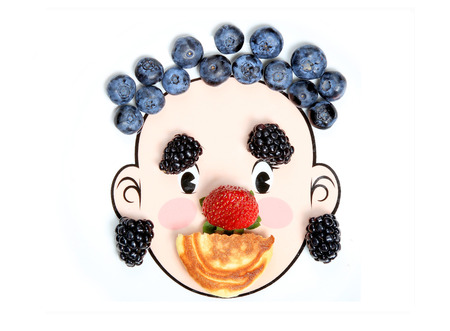 Happy face made with fresh strawberry, blueberry, raspberry, blackberry and pancake.