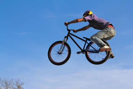 sports bar: teenager on bicycle, extreme sports. Stock Photo