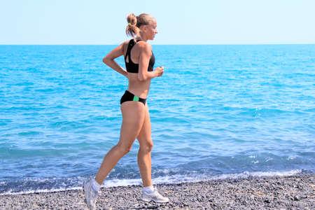 women running sea beach Stock Photo
