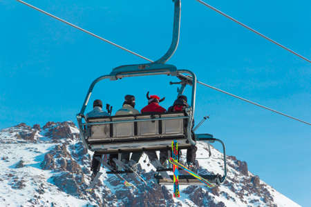 Snowboarders on chair-lift