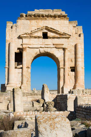Trajan`s Arch, the Ruins of Ancient Mactaris (Makthar) in Tunisia Stock Photo