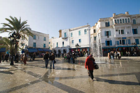 TUNIS - DECEMBER O4  A crowed of unidentified people walk at the  Place de la Victoire  on December 04, 2009 in Tunis  Place de la Victoire is the entrance to the medina in Tunis  Stock Photo - 12943397
