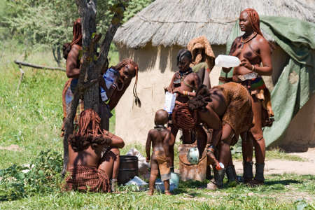 himba people prepare lunch in village