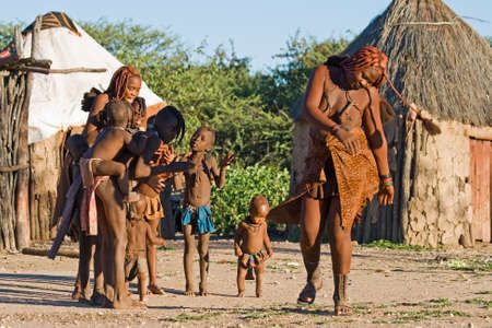 Himba people perform traditional dance in namibian village