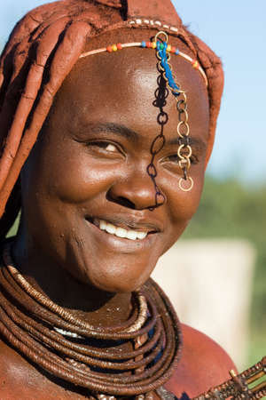 Himba woman portrait on blue sky background photo