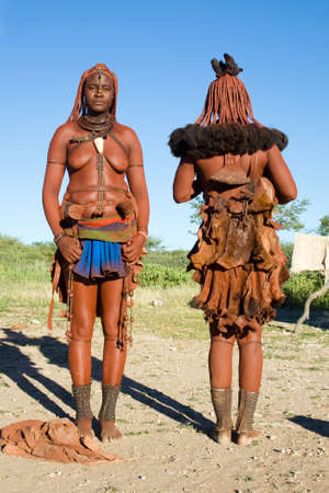 Himba women - full length Himba women in traditional clothes photo