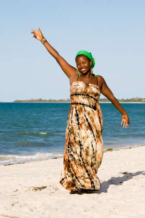 Uganda woman enjoys the beach in Tanzania
