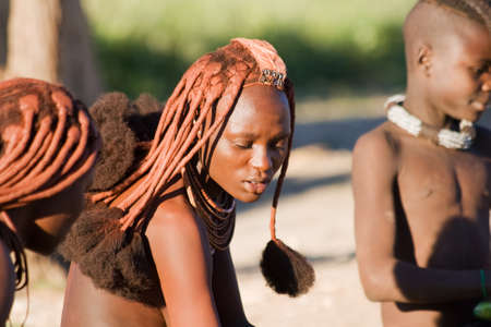 nomad: Young Himba woman with traditional hairstyle  Editorial