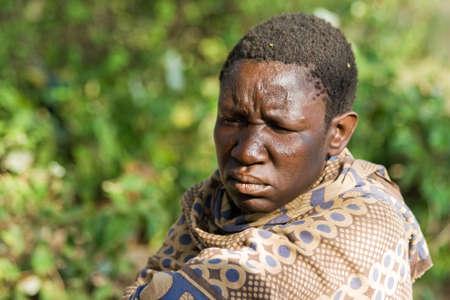 hunter gatherer: LAKE EYASI, TANZANIA - FEBRUARY 18  An unidentified Hadzabe woman looks seriously in the bush on February 18, 2013 in Tanzania  Hadzabe tribe threatened by extinction