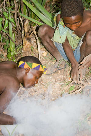 hunter gatherer: LAKE EYASI, TANZANIA - FEBRUARY 18: Two unidentified men from Hadza tribe light a fire in the bush, on February 18, 2013 in Tanzania. Hadzabe tribe threatened by extinction.