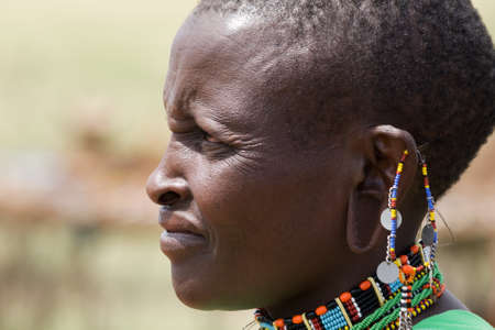 Native Masai woman portrait with traditional jewelry from beside