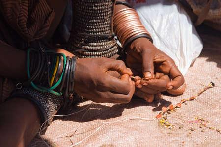 Closeup of Himba woman making jewelry Stock Photo - 21090540