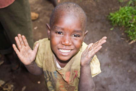 kisoro: KISORO, UGANDA - DECEMBER 31, 2013  Portrait of an unidentified pygmy child smiles into the camera  Editorial