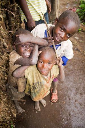 KISORO, UGANDA - DECEMBER 31, 2013  Portrait of unidentified pygmy children smile into the camera and make fun  Editorial