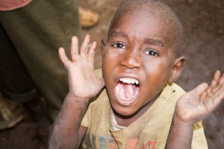 kisoro: KISORO, UGANDA - DECEMBER 31, 2013  Scream of a unidentified pygmy child